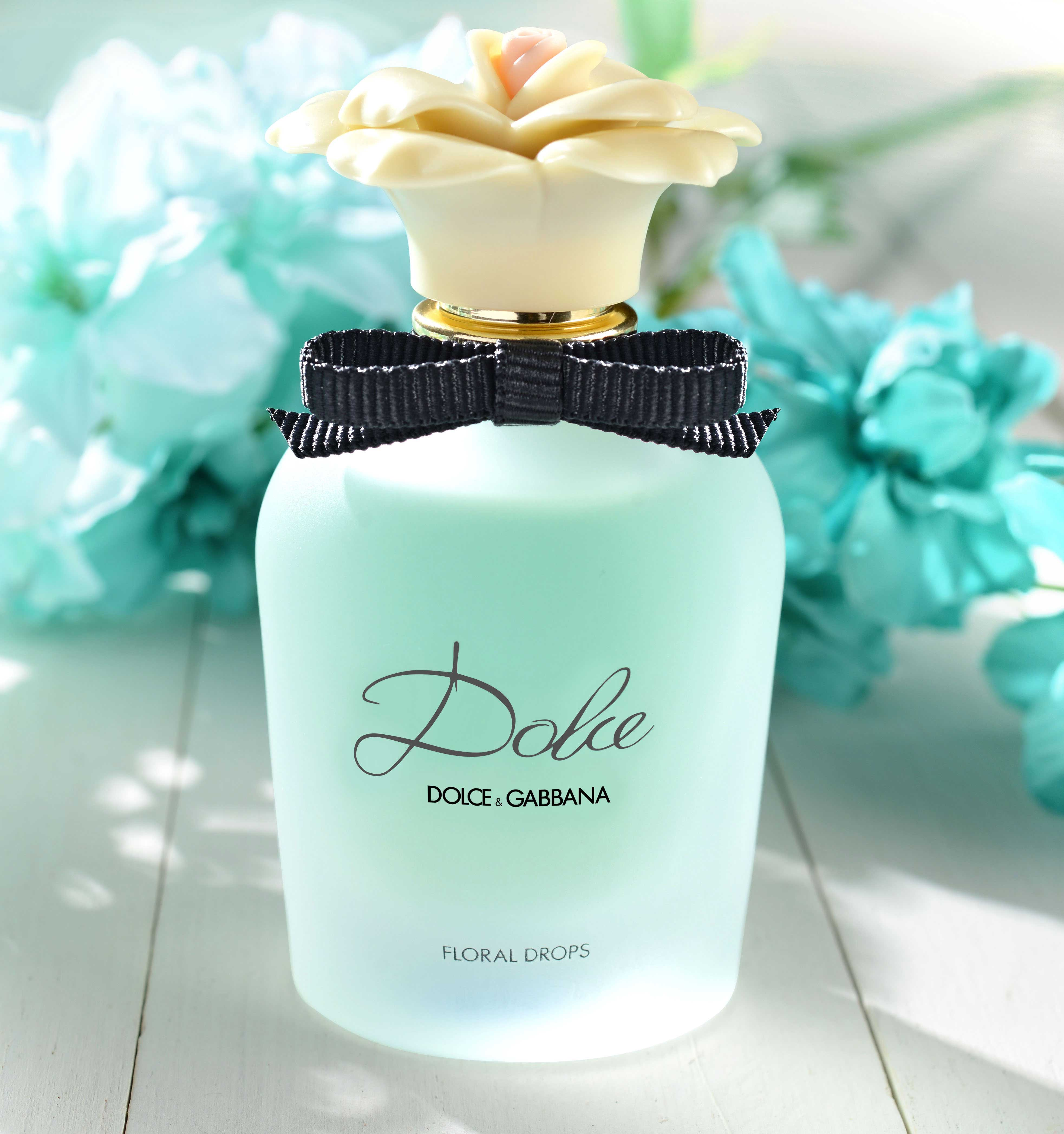 mike wepplo photoreal photography Dolce perfume bottle with flowers