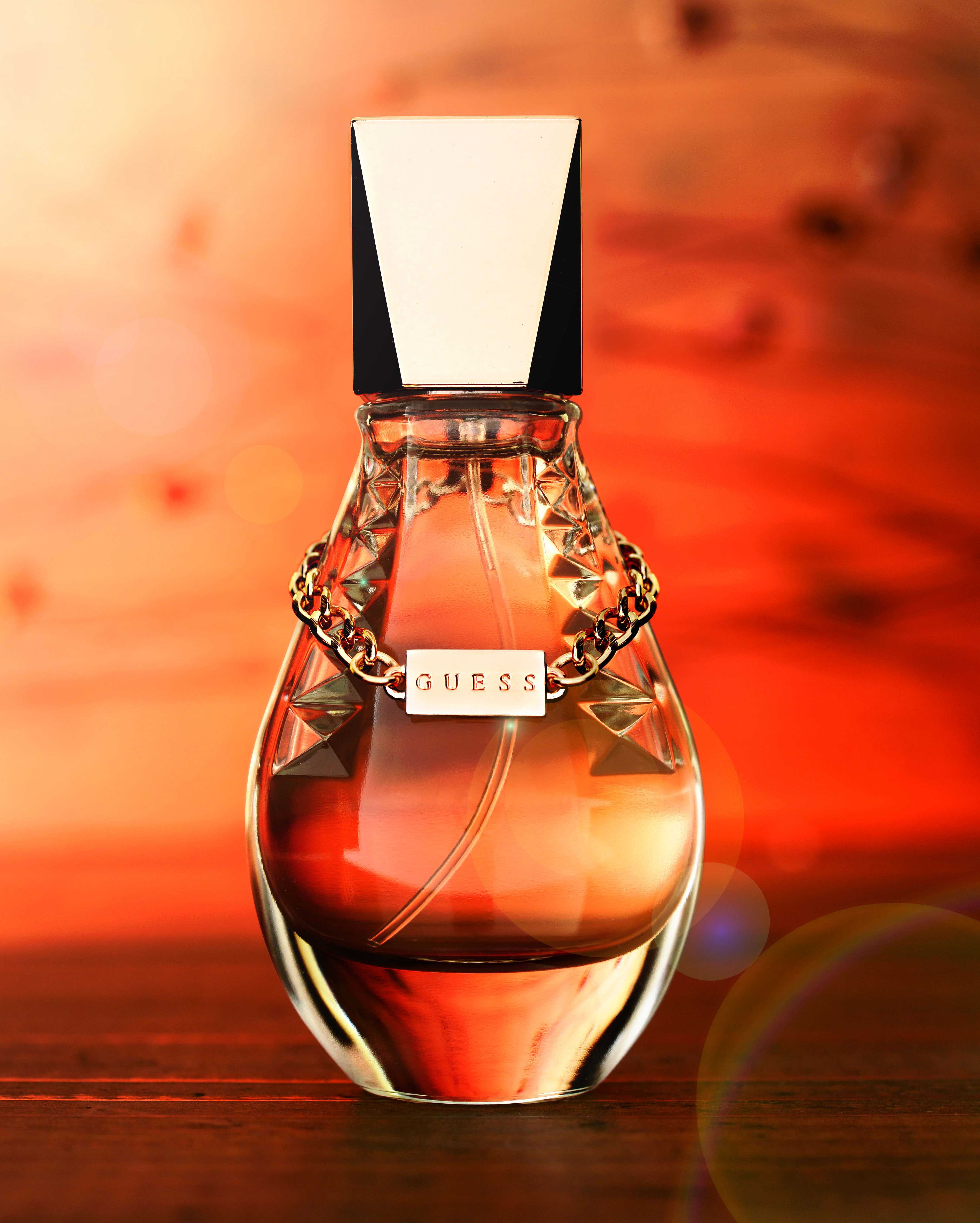 mike wepplo photoreal photography guess. perfume bottle