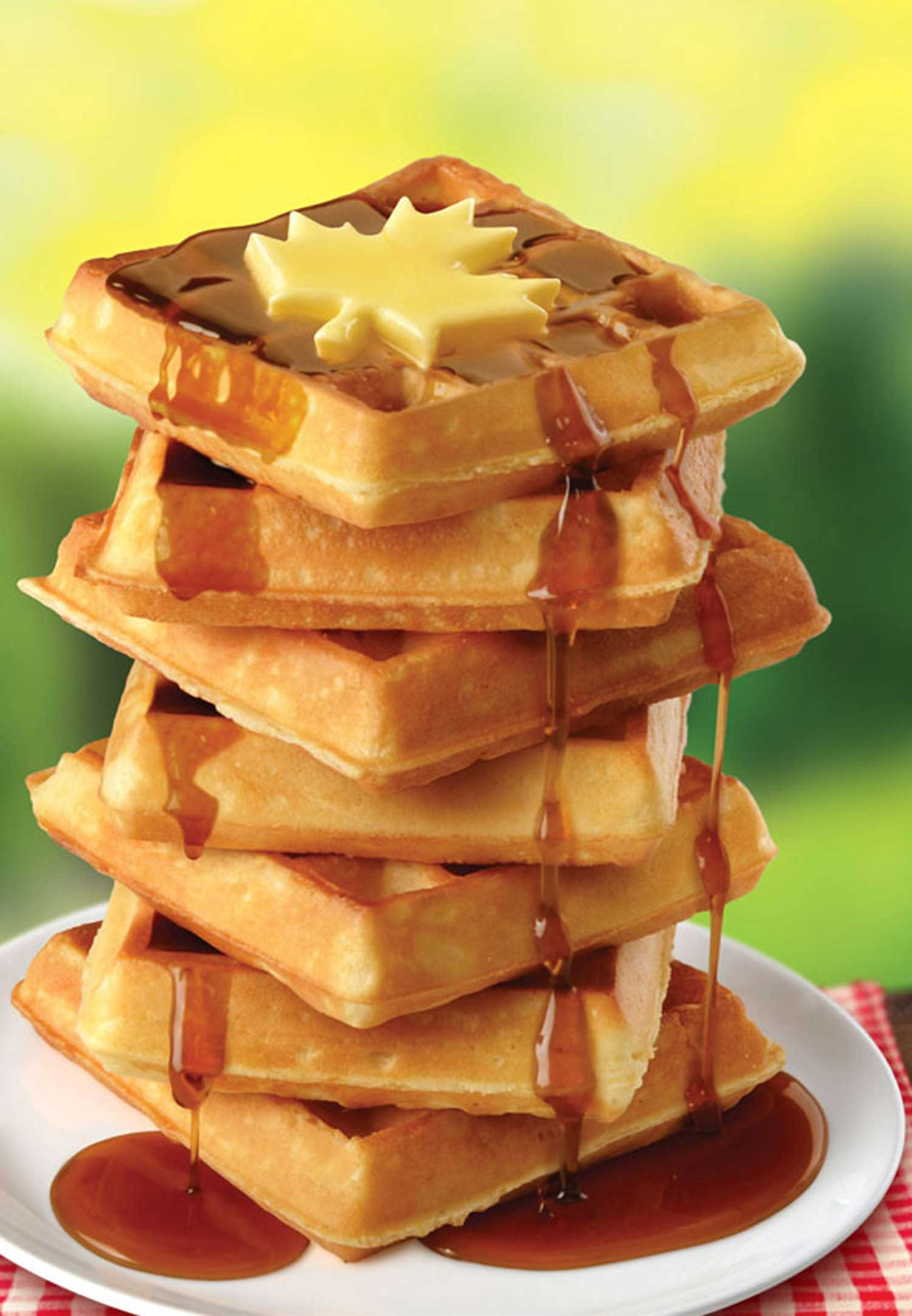 mike wepplo photoreal photography waffle stack with maple syrup drizzle