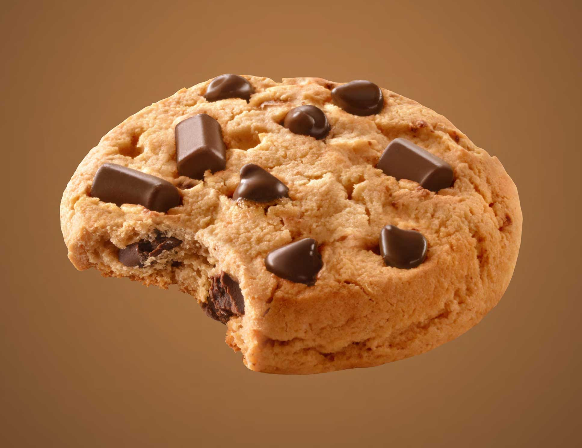 mike wepplo photoreal photography chocolate chip cookie with bite